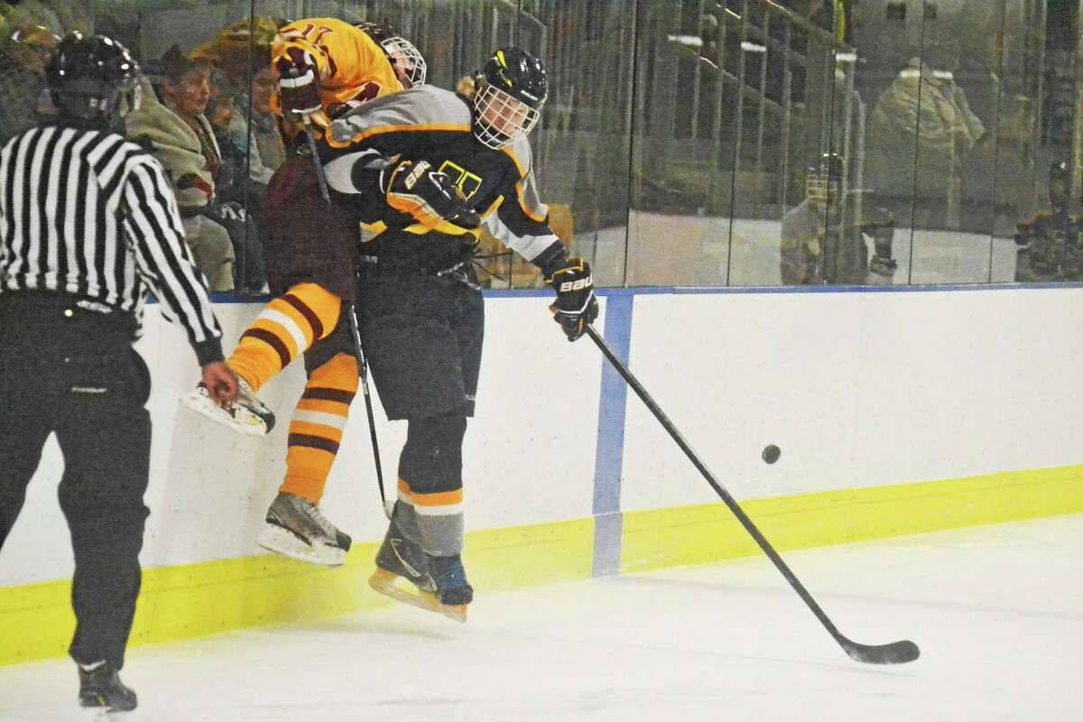 Housatonic-Northwestern-Wamogo's Wes Reel lays a hit on a Sheehan's Jimmy McNamee. The game ended in a 2-2 tie.