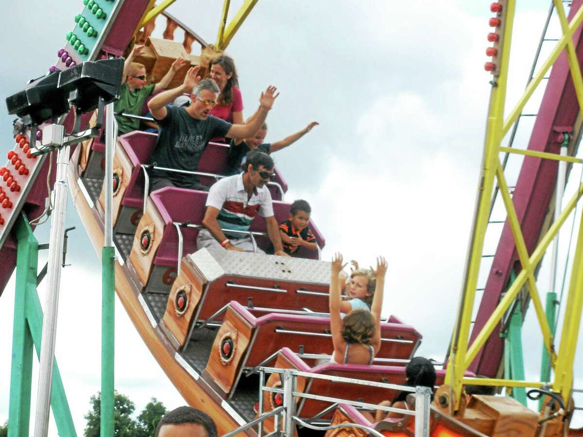 Fairgoers enjoy one of the many rides available at the 102nd Goshen Fair at the Goshen Fairgrounds Monday.