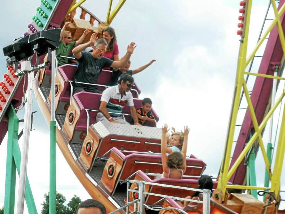 Fairgoers enjoy one of the many rides available at the 102nd Goshen Fair at the Goshen Fairgrounds Monday. Photo: Stephen Underwood — The Register Citizen
