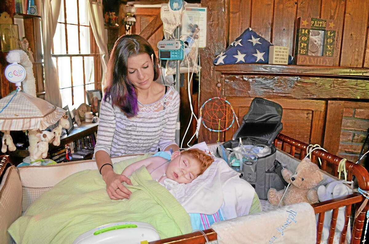 Lauren Straub and her two-year-old son Finn in their Harwinton home.