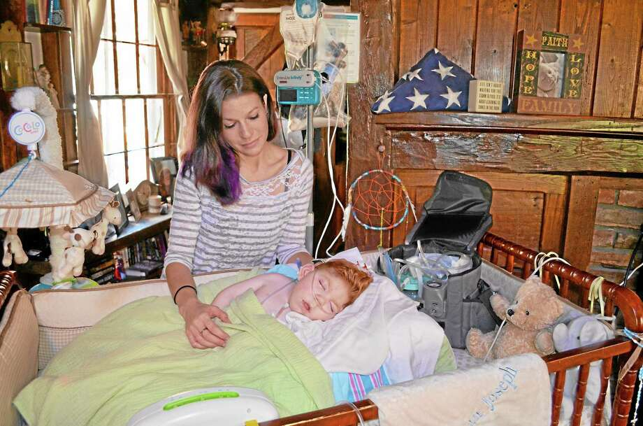 Lauren Straub and her two-year-old son Finn in their Harwinton home. Photo: Kate Hartman—Register Citizen