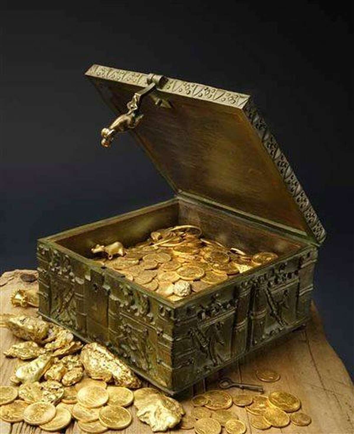 This undated photo provided by Forrest Fenn shows a chest purported to contain gold dust, hundreds of rare gold coins, gold nuggets and other artifacts. For more than a decade, the 82-year-old claims he has packed and repacked the treasure chest, before burying it in the mountains somewhere north of Santa Fe. (AP Photo/Jeri Clausing)