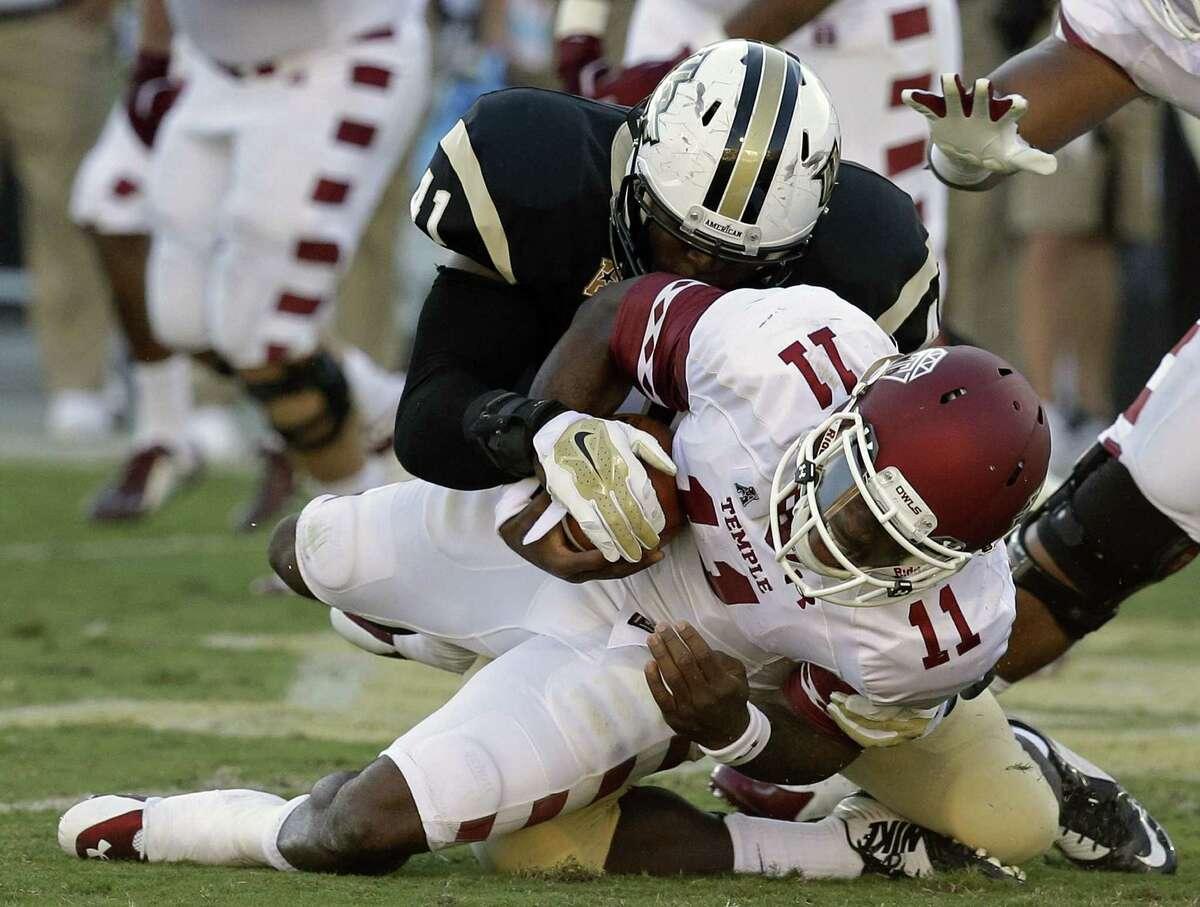 Central Florida linebacker Terrance Plummer sacks Temple quarterback P.J. Walker in the first half of last Saturday's game in Orlando, Fla.