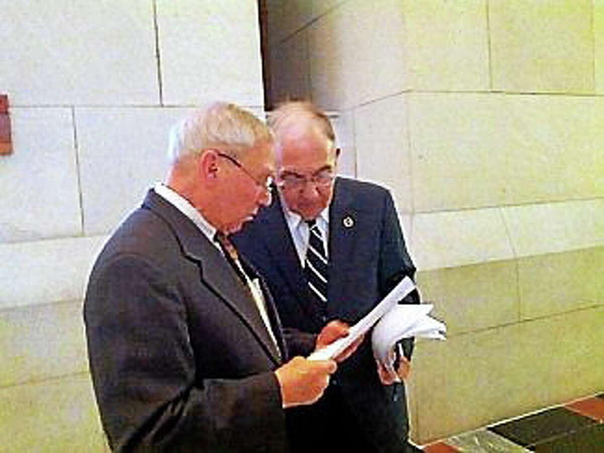 Retired Supreme Court Justice David Borden talks to Majority Leader Martin Looney.