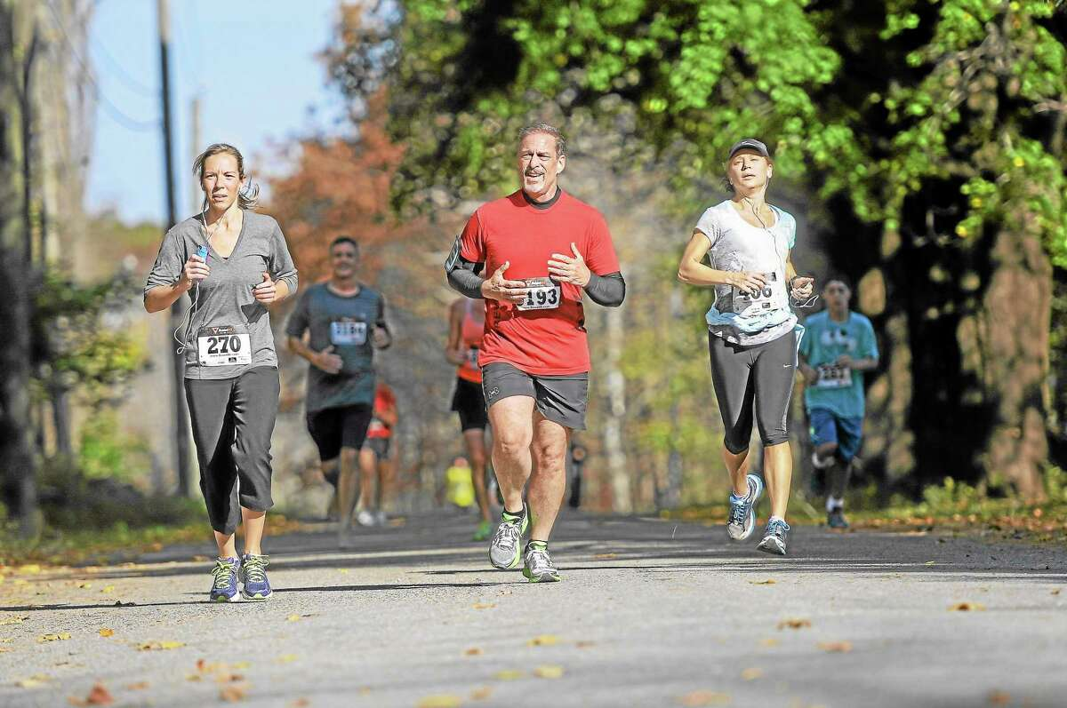 Runners compete in the sixth-annual Cider Run 5K in Warren on Saturday, Oct. 19. See a gallery of race photos online at Media.RegisterCitizen.com