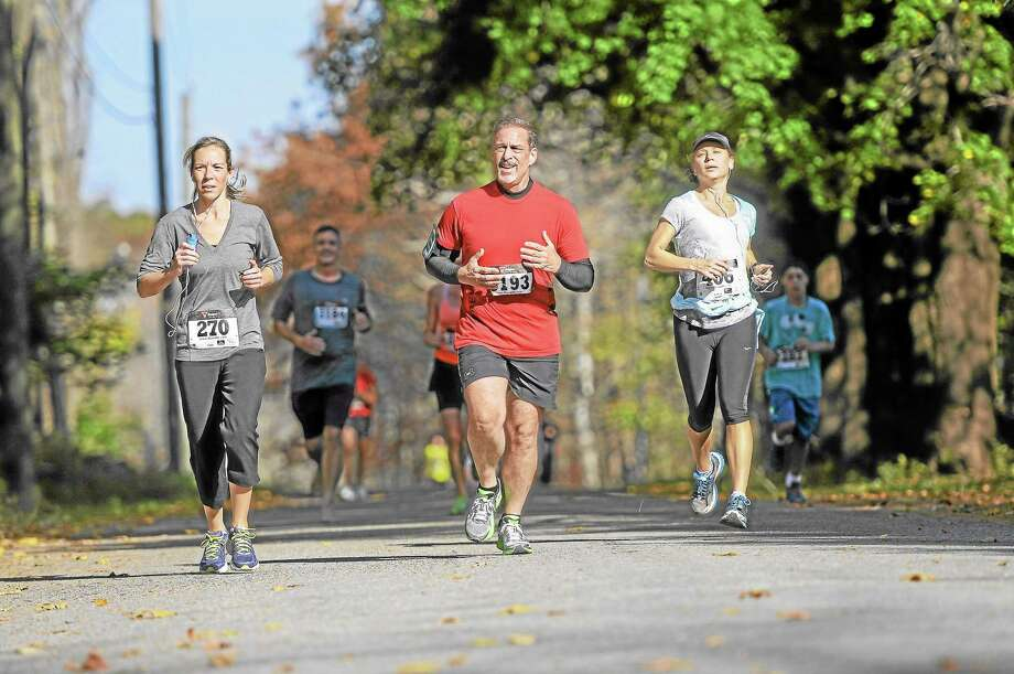 Runners compete in the sixth-annual Cider Run 5K in Warren on Saturday, Oct. 19. See a gallery of race photos online at Media.RegisterCitizen.com Photo: Laurie Gaboardi—Register Citizen
