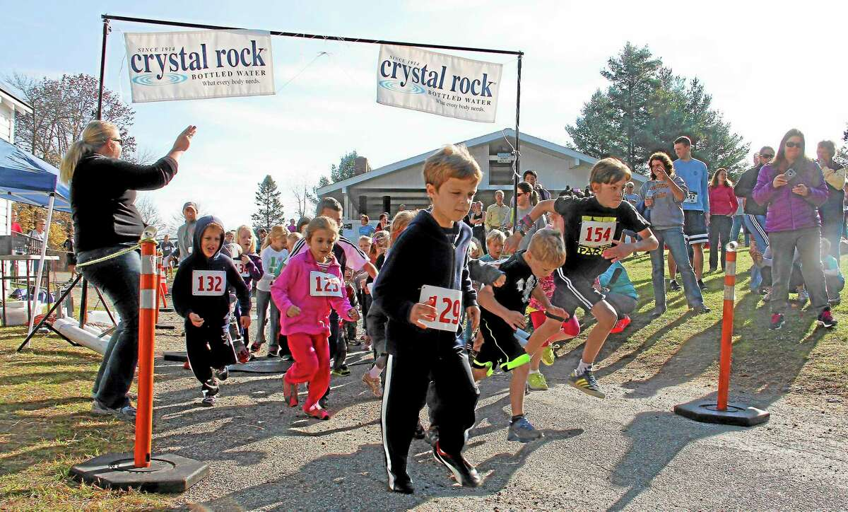 Children start running during the Fun Run race of the Cider Run 5K in Warren on Saturday, Oct. 19. The children ran a small portion of the 5K before adults and some teenager runner took the course to help raise money for a scholarship fund.