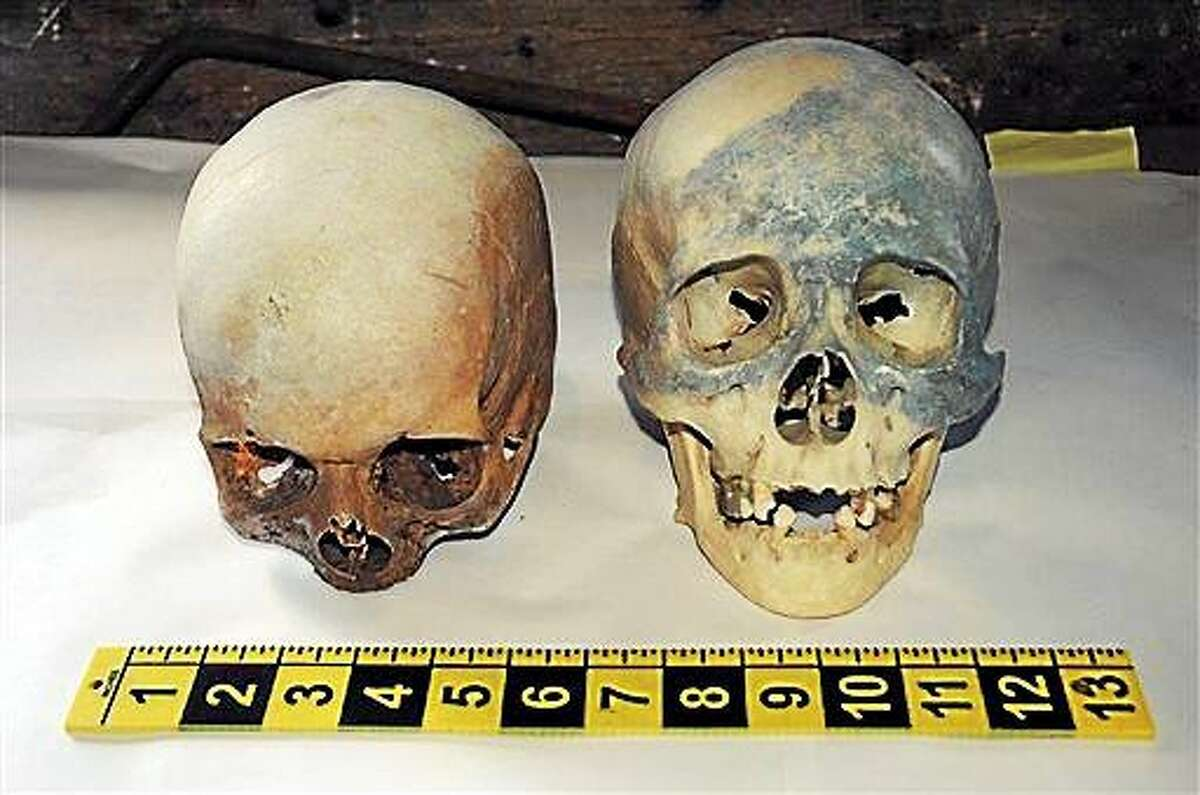 In this photo released by the Stamford, Conn., Police Department Friday, Oct. 31, 2014, two human skull are displayed, which were found at the Stamford Refuge Transfer Station. Police said the skulls were found Thursday afternoon along with books on Satan and witchcraft.