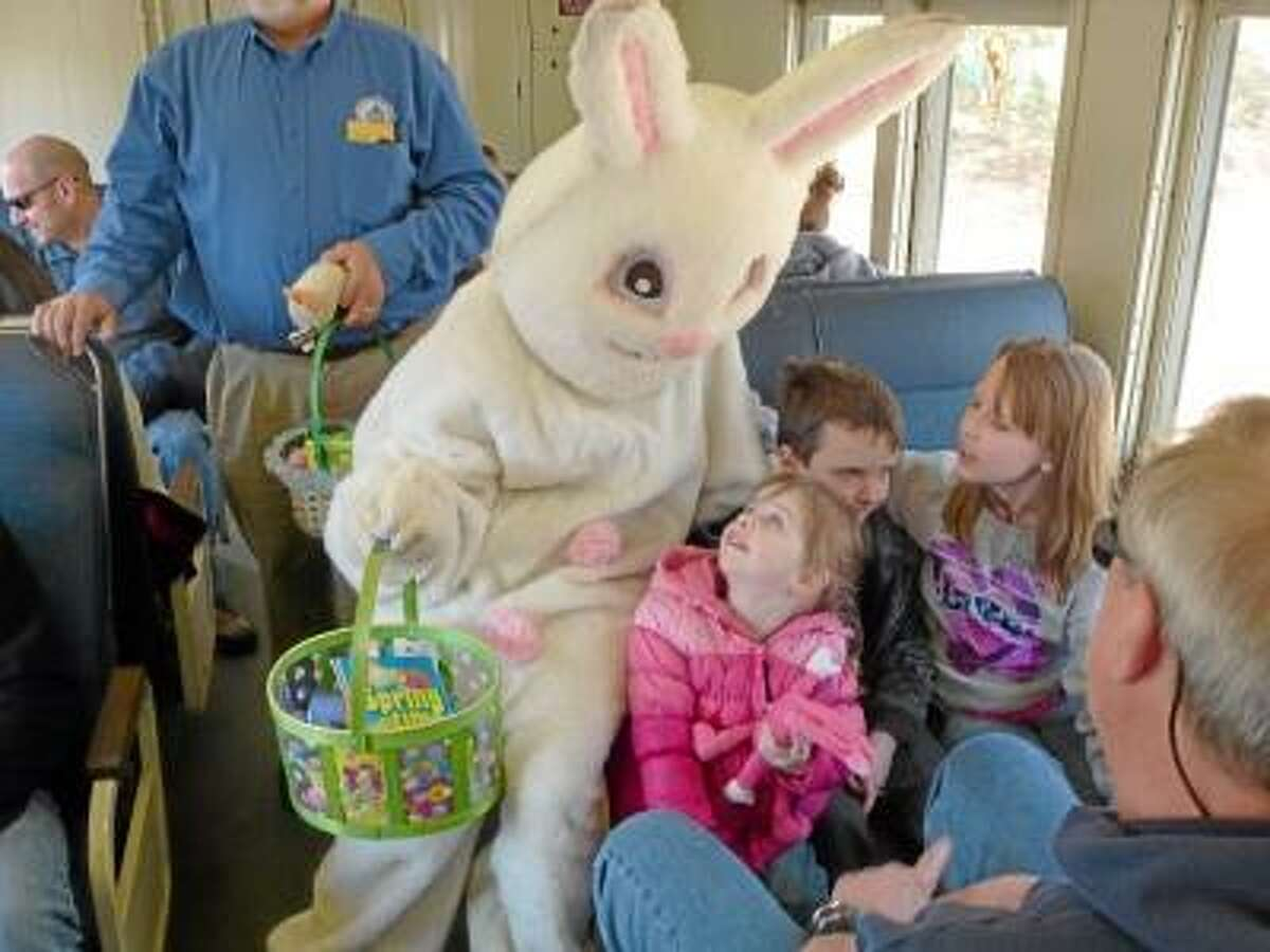 Ryan Flynn/Register Citizen Aboard the Easter Bunny Express in Thomaston, children picked out toys and stuffed animals from the Easter Bunny's basket.