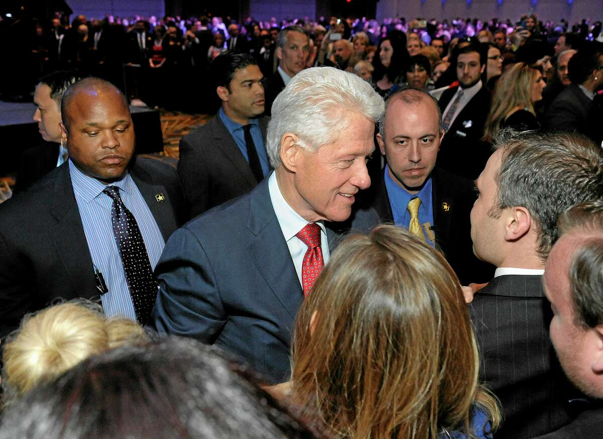 Former President Bill Clinton greets supporters after he delivered the keynote at the annual Jefferson-Jackson Dinner at Cobo Hall in Detroit, Mich., Saturday, April 26, 2014. (AP Photo/Jose Juarez)