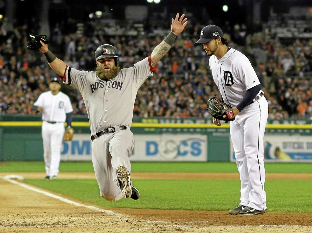 Boston's Mike Napoli scores on a wild pitch by the Tigers' Anibal Sanchez in the third inning during Game 5 of the ALCS on Thursday.