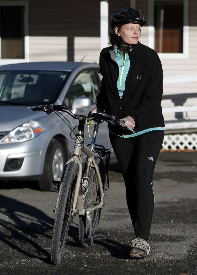 Nurse Kaci Hickox leaves her home on a rural road in Fort Kent, Maine, to take a bike ride with her boyfriend Ted Wilbur, Thursday, Oct. 30, 2014.  (AP Photo/Robert F. Bukaty) Photo: AP / AP