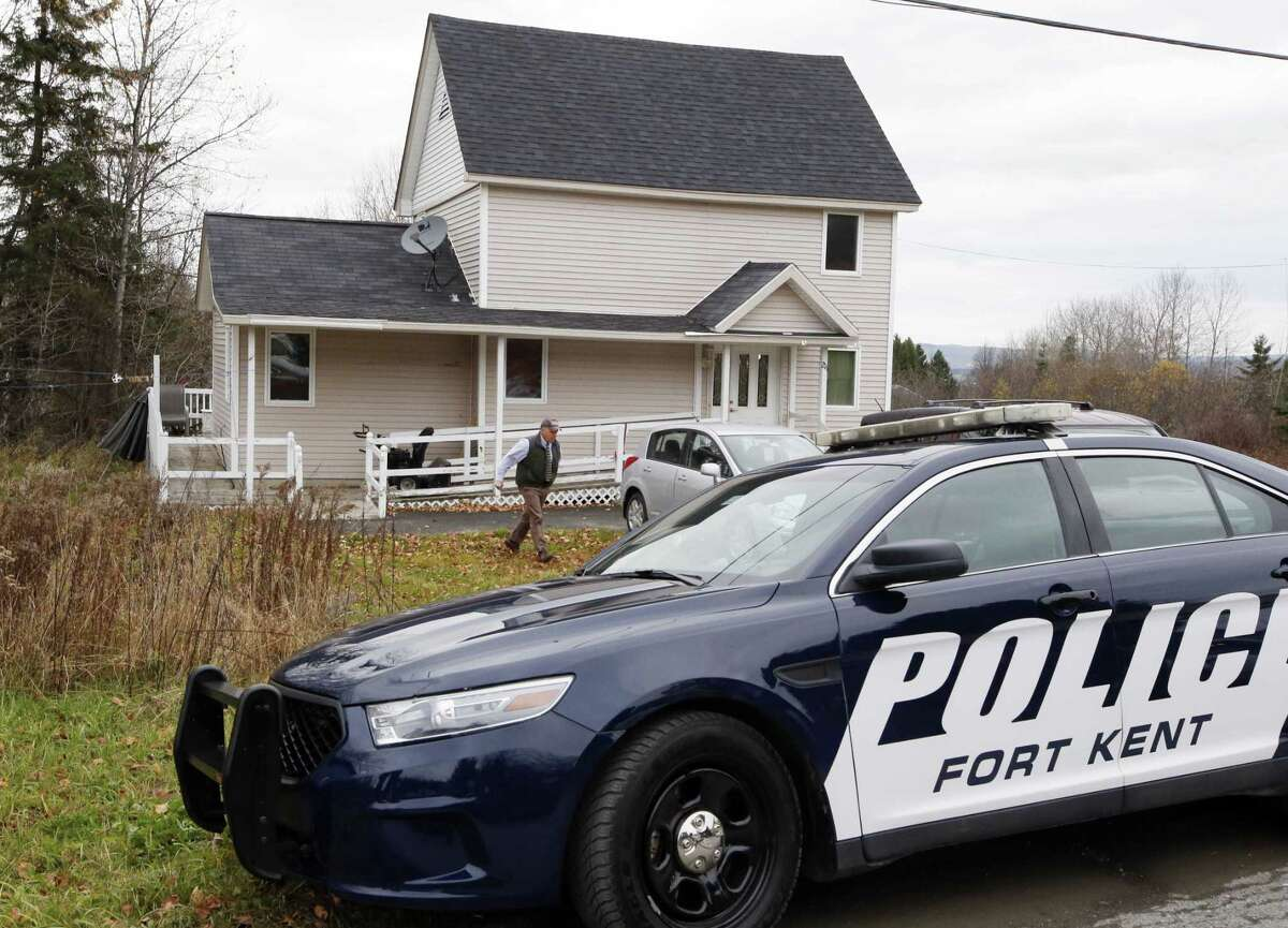 Fort Kent Police Chief Thomas Pelletier leaves the home of nurse Kaci Hickox after a brief visit, Friday, Oct. 31, 2014, in Fort Kent, Maine. ( AP Photo/Robert F. Bukaty)