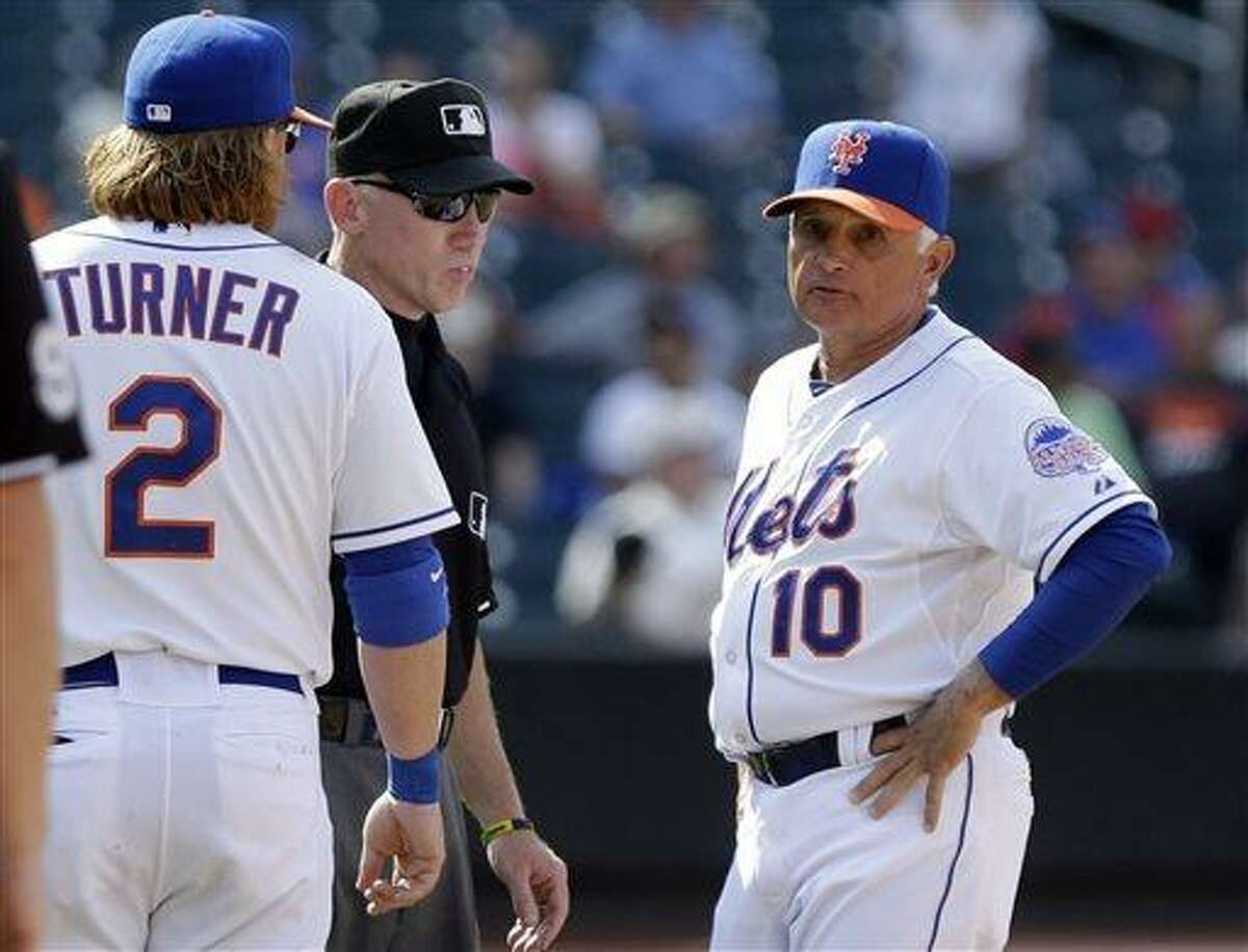 New York Mets manager Terry Collins (10) argues a call with umpire Lance Barksdale as Justin Turner (2) looks on during the ninth inning of a baseball game against the Chicago Cubs Saturday, June 15, 2013, in New York. (AP Photo/Frank Franklin II)