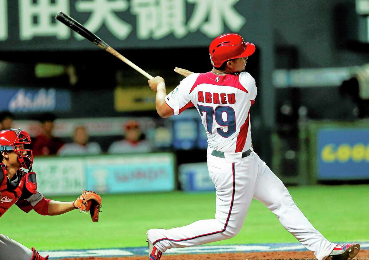 Cuba first baseman Jose Abreu hits a grand slam in the fifth inning of a World Baseball Classic game against China in Fukuoka, Japan, on March 4.