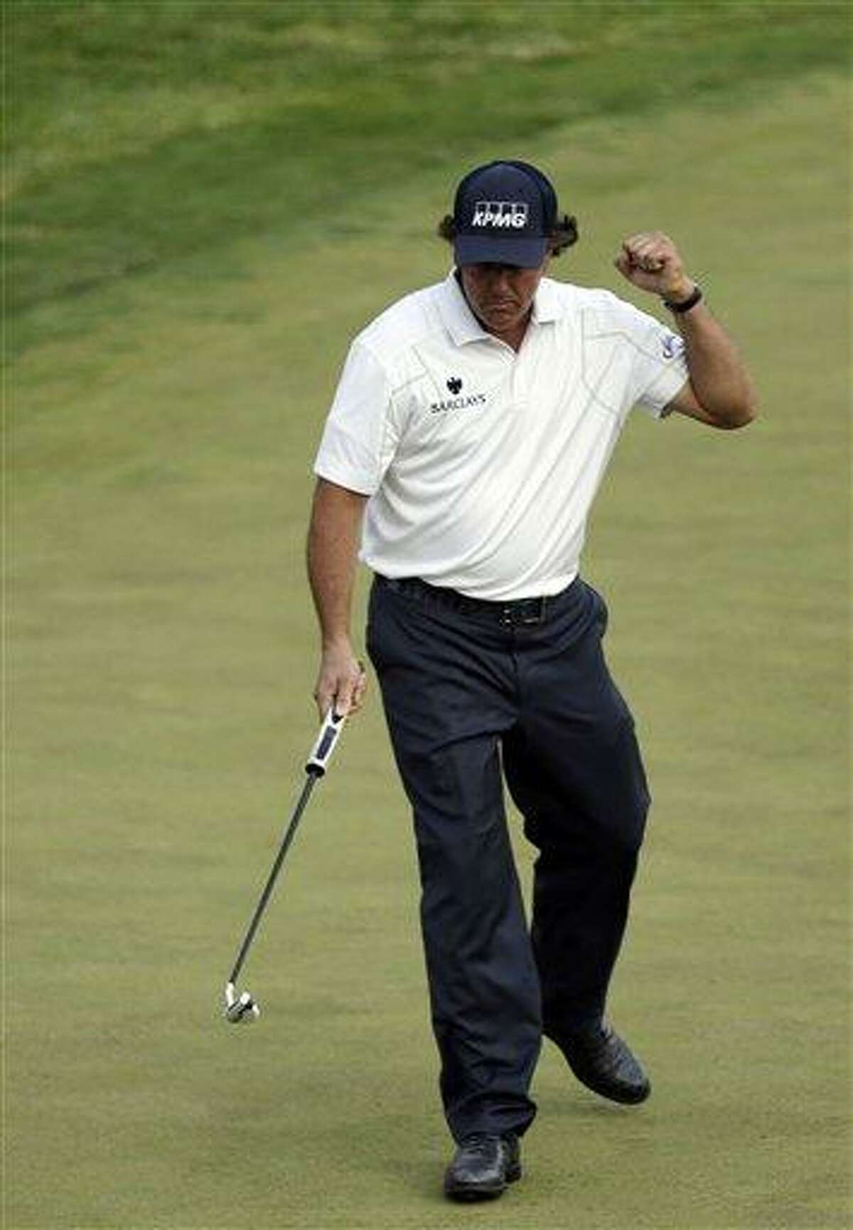 Phil Mickelson reacts after putting on the 17th hole during the third round of the U.S. Open golf tournament at Merion Golf Club, Saturday, June 15, 2013, in Ardmore, Pa. (AP Photo/Julio Cortez)