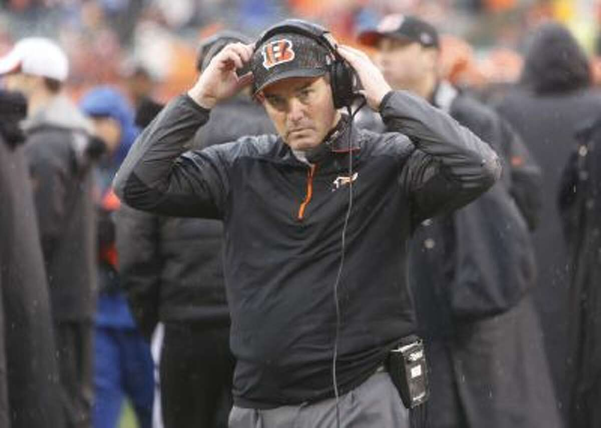 Cincinnati Bengals defensive coordinator Mike Zimmer adjusts his head set in the second half of an NFL wild-card playoff football game against the San Diego Chargers Sunday, Jan. 5, 2014.