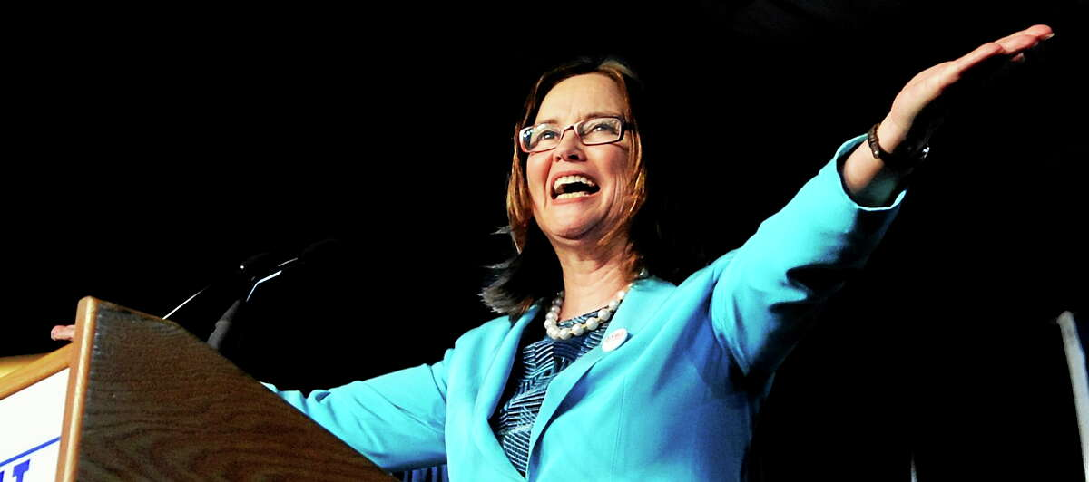 Denise Merrill cheers at the podium after she was nominated as Secretary of the State at the Democratic state convention on May 22, 2010.