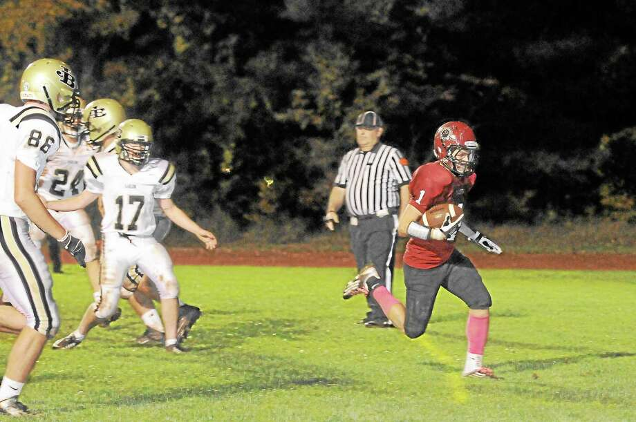 Torrington's Zak Mancini scores from two-yards out for the Red Raiders lone rushing touchdown. Photo: Laurie Gaboardi — Register Citizen