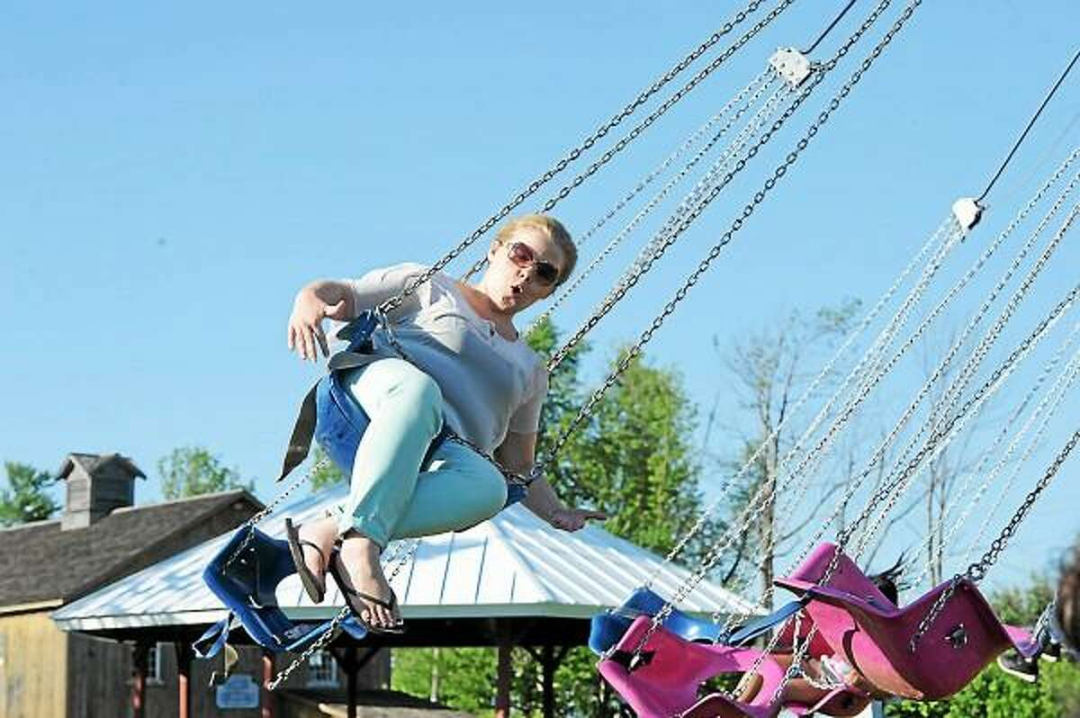 A woman enjoys one of the rides Saturday at the 2013 Goshen Stampede, held at the Goshen Fairgrounds. (Laurie Gaboardi-Litchfield County Times)