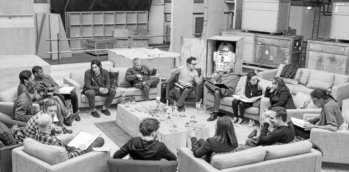 This Tuesday, April 29, 2014, photo provided by Lucasfilm shows Star Wars writer/director/producer J.J. Abrams, rear center, at the cast read-through of Star Wars: Episode VII at Pinewood Studios near London. Clockwise from top right are Harrison Ford, Daisy Ridley, Carrie Fisher, Peter Mayhew, producer Bryan Burk, Lucasfilm President and Producer Kathleen Kennedy, Domhnall Gleeson, Anthony Daniels, Mark Hamill, Andy Serkis, Oscar Isaac, John Boyega, Adam Driver and writer Lawrence Kasdan.
