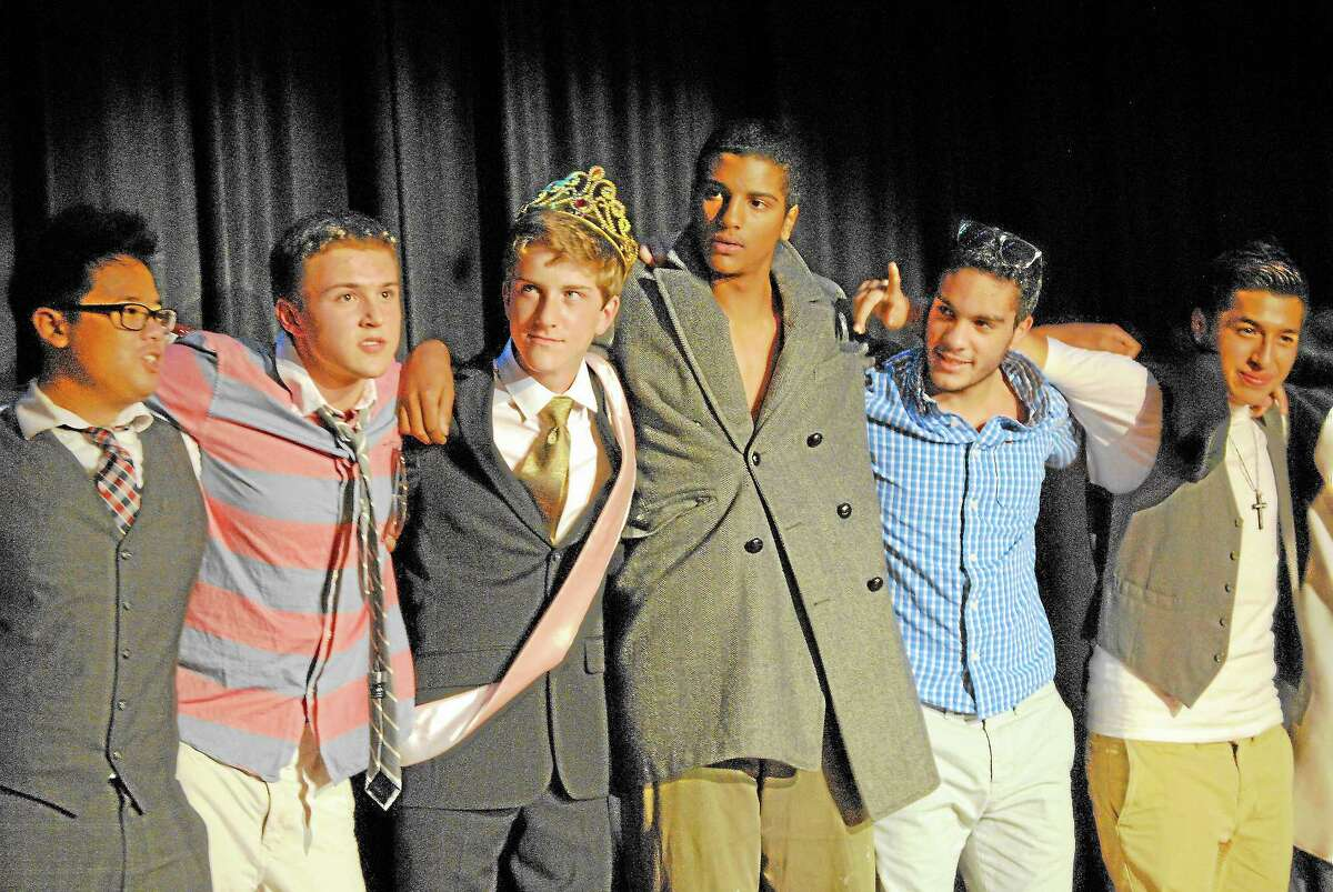"""The winner of Torrington High School's Homecoming male beauty pageant, """"Mr. Raider,"""" is junior Tom Killackey, standing with other contestants in the Little Theater stage Thursday night."""