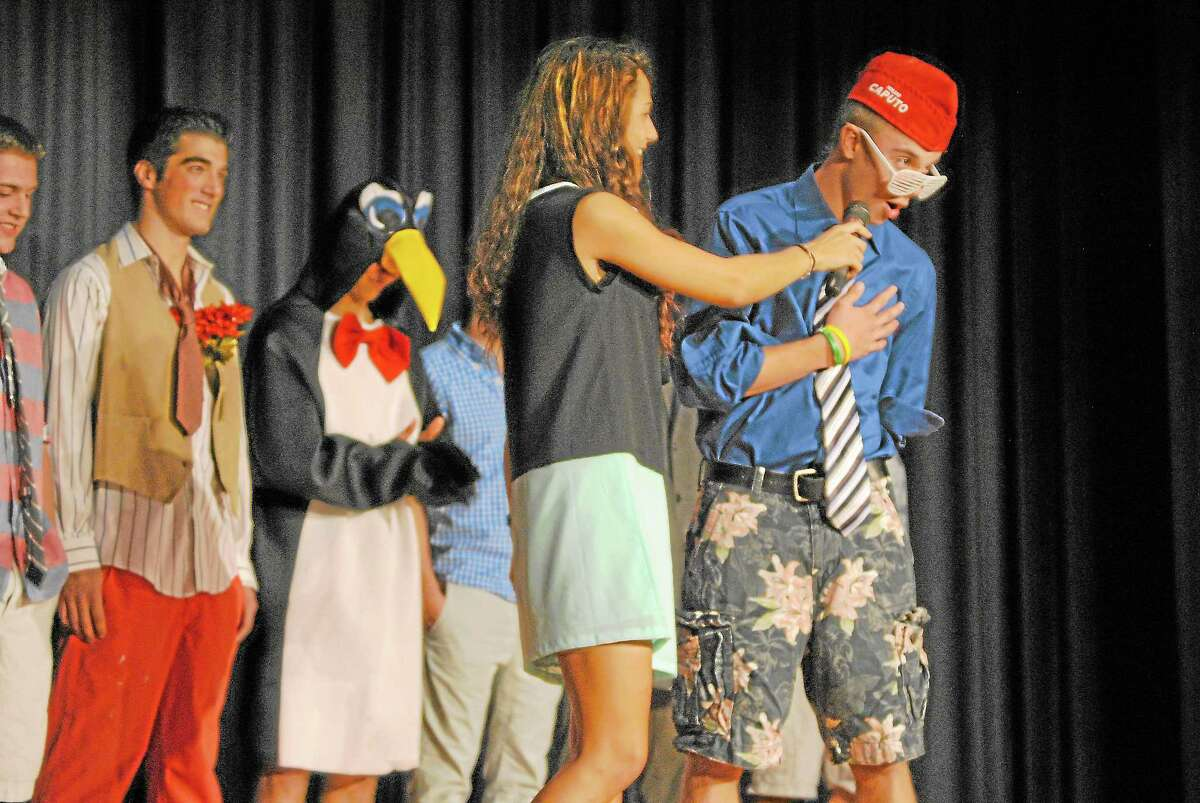 """Ethan Barbieri, a contestant in Torrington High School's homecoming male beauty contest """"Mr. Raider,"""" answers a question on Torrington High School's Little Theater stage."""