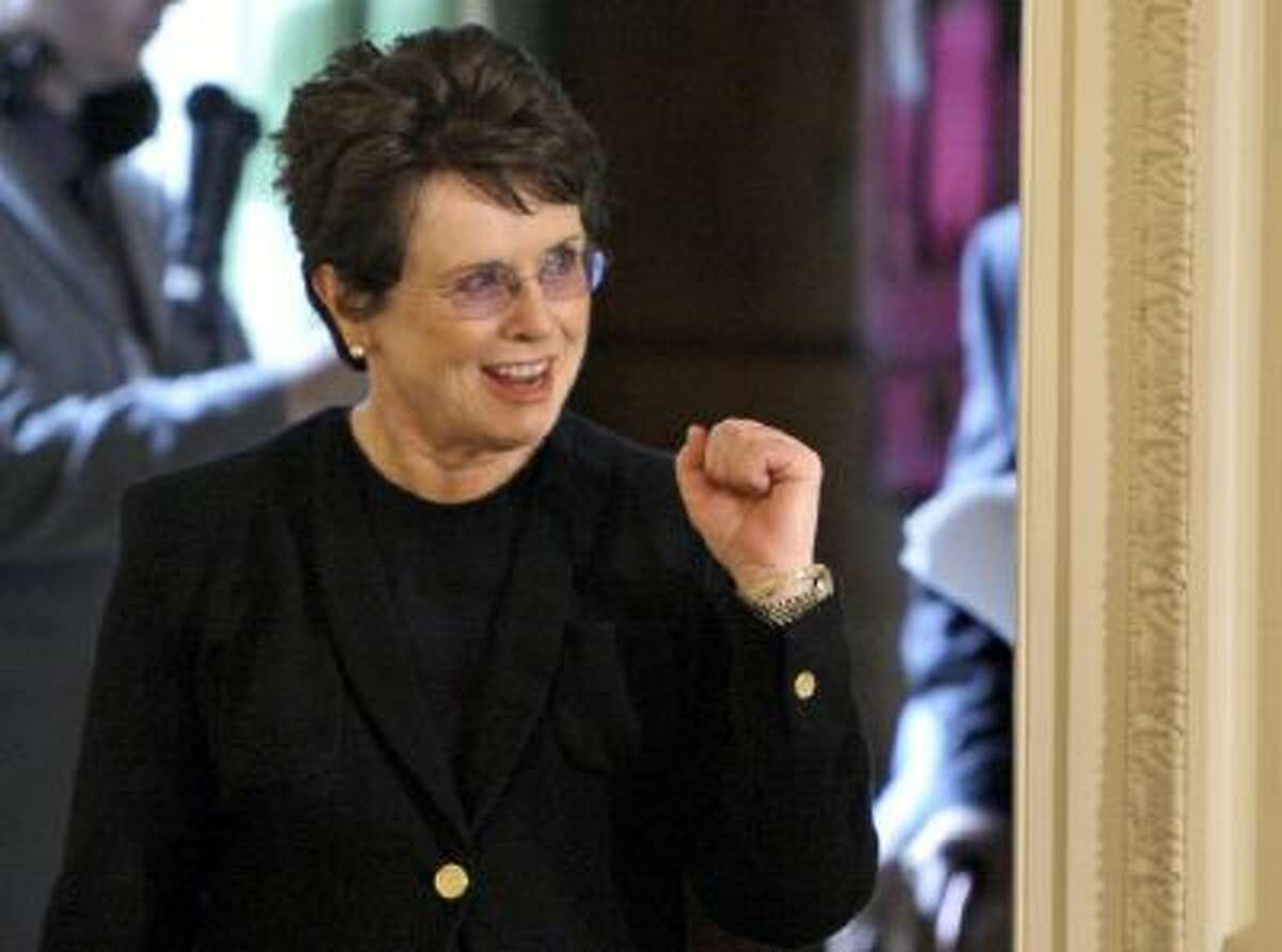 Tennis great Billie Jean King reacts as she enters the East Room of the White House in Washington, for a ceremony where President Barack Obama awarded her a 2009 Presidential Medal of Freedom.