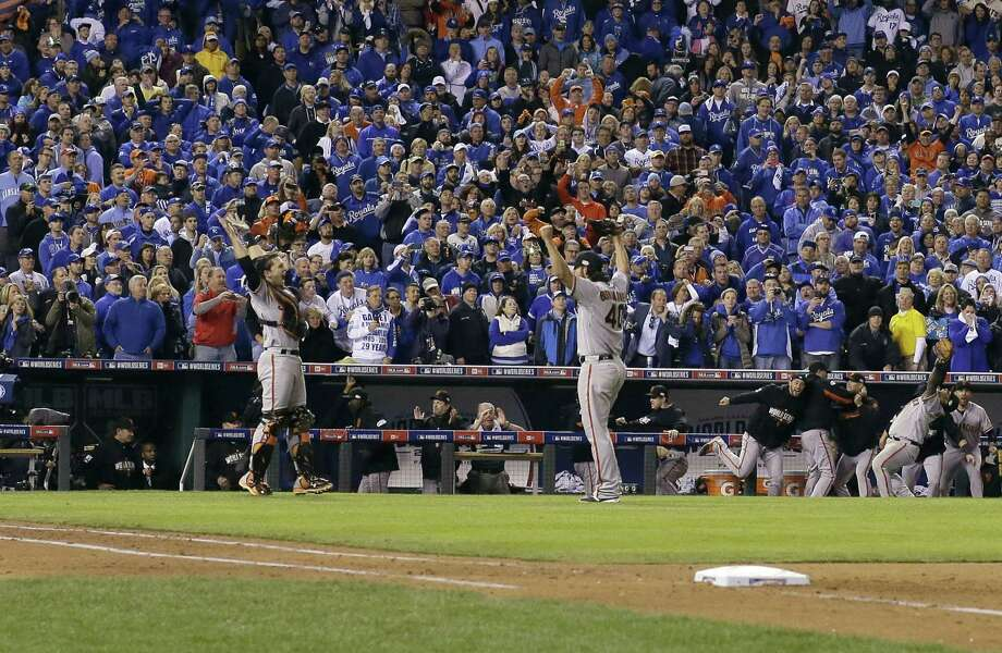 San Francisco Giants catcher Buster Posey and pitcher Madison Bumgarner celebrate after Game 7 of the World Series on Wednesday in Kansas City, Mo. The Giants won 3-2 to win the series. Photo: David J. Phillip — The Associated Press  / AP
