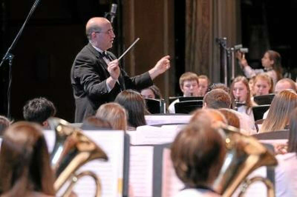 Photos by Marianne Killackey Wayne Splettstoeszer conducts the Torrington High School Concert Band as they perform in the Tri Town Band Festival, a collaborative effort of Torrington, Northwestern Regional 7, and Canton High Schools. The concert was held at the Warner Theatre on Tuesday night.