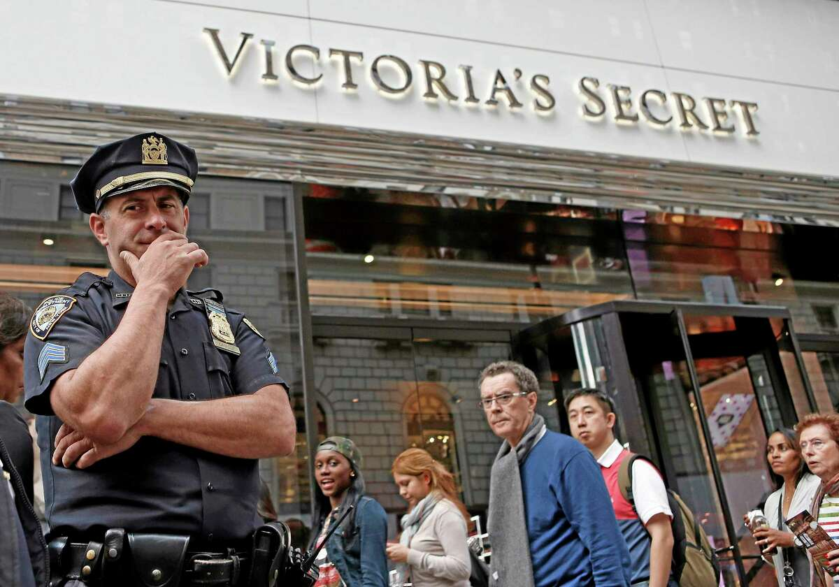 A New York City police officer stands in front of the Victoria's Secret Herald Square store in midtown Manhattan, Thursday, Oct. 17, 2013, in New York. A security guard on the lookout for shoplifters searched two teenage girls as they left the lingerie shop Thursday afternoon, and discovered one of them was carrying what appeared to be a fetus in her bag, police said. (AP Photo/Kathy Willens)