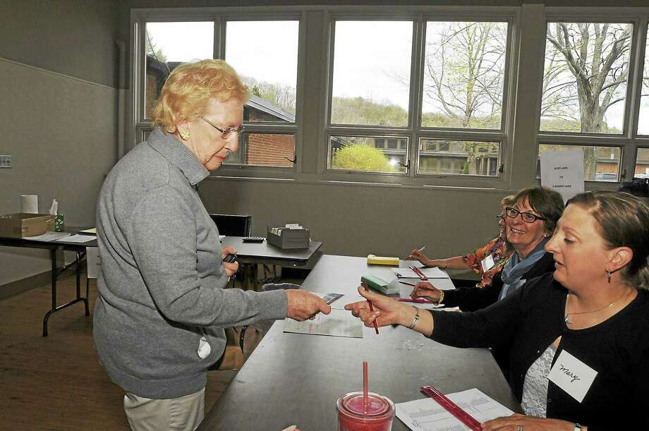 Gloria Benedict checks in to vote in Burlington Tuesday as the town residents vote on the proposed budget for Region 10. Photo: Laurie Gaboardi — Register Citizen