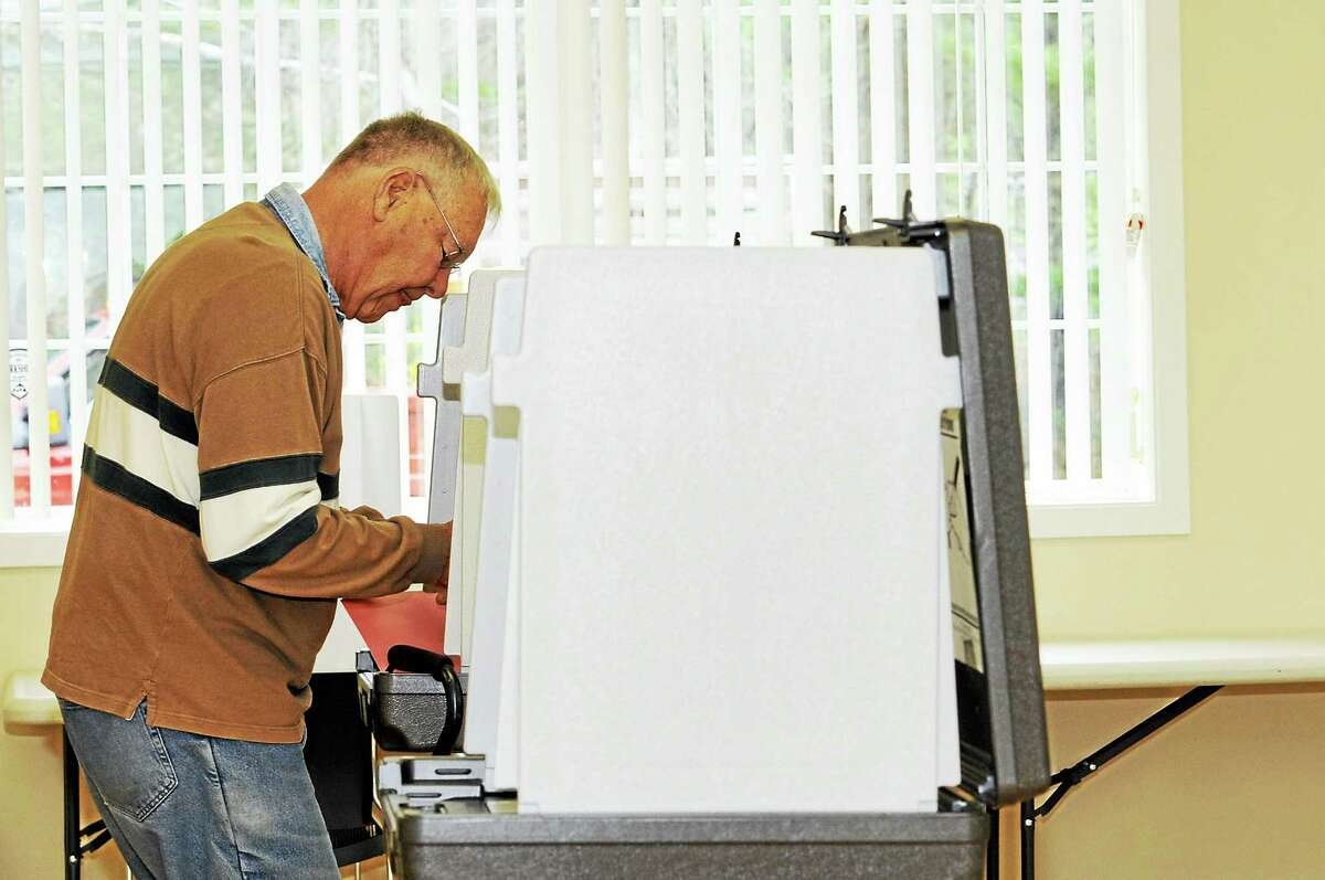 Tom Nelson votes in Barkhamsted Tuesday.