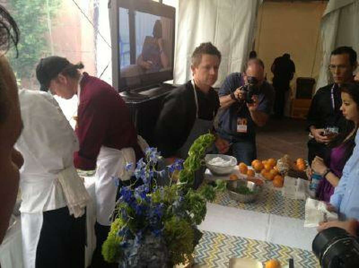 Top Chef victor Richard Blais serving lobster rolls at the Food & Wine Classic.