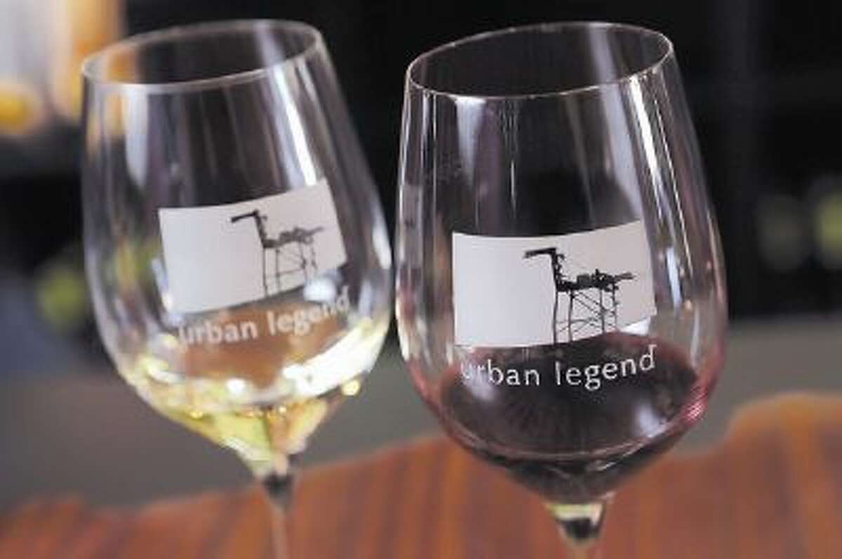 An unmistakable reminder of the East Bay waterfront is prominently featured on the wine-tasting glasses featured at Oakland's Urban Legend Cellars winery in Oakland.