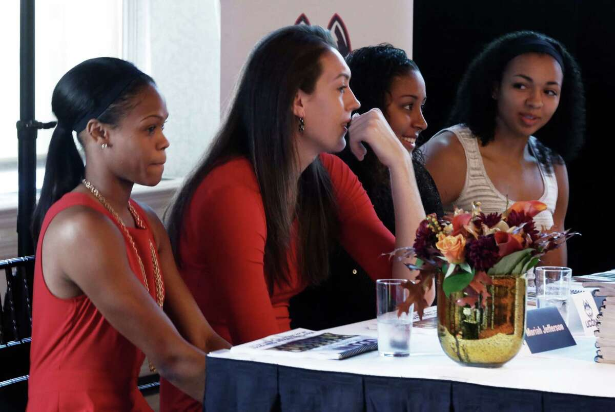 From left, UConn's Moriah Jefferson, Breanna Stewart, Kaleena Mosqueda-Lewis and Kiah Stokes listen to coaches' remarks during the American Athletic Conference women's basketball media day on Thursday in New York.