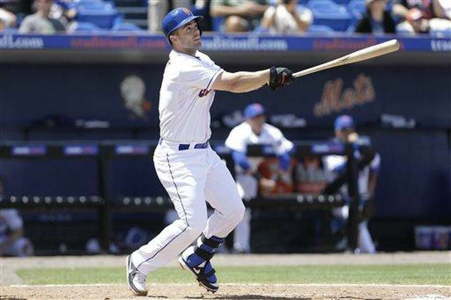 New York Mets' David Wright flies out during the fifth inning of an exhibition spring training baseball game against the St. Louis Cardinals Friday, March 29, 2013, in Port St. Lucie, Fla. (AP Photo/Jeff Roberson) Photo: ASSOCIATED PRESS / AP2013