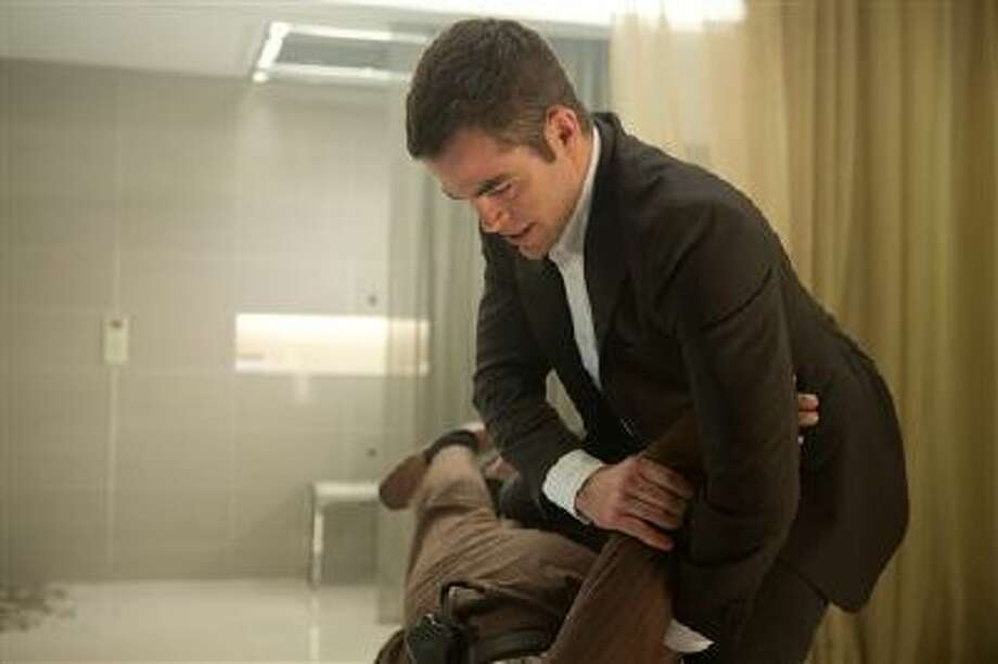 """This image released by Paramount Pictures shows Chris Pine in """"Jack Ryan: Shadow Recruit,"""" an action thriller about a young covert CIA analyst who uncovers a Russian plot to crash the U.S. economy with a terrorist attack. Photo: AP / Paramount Pictures"""