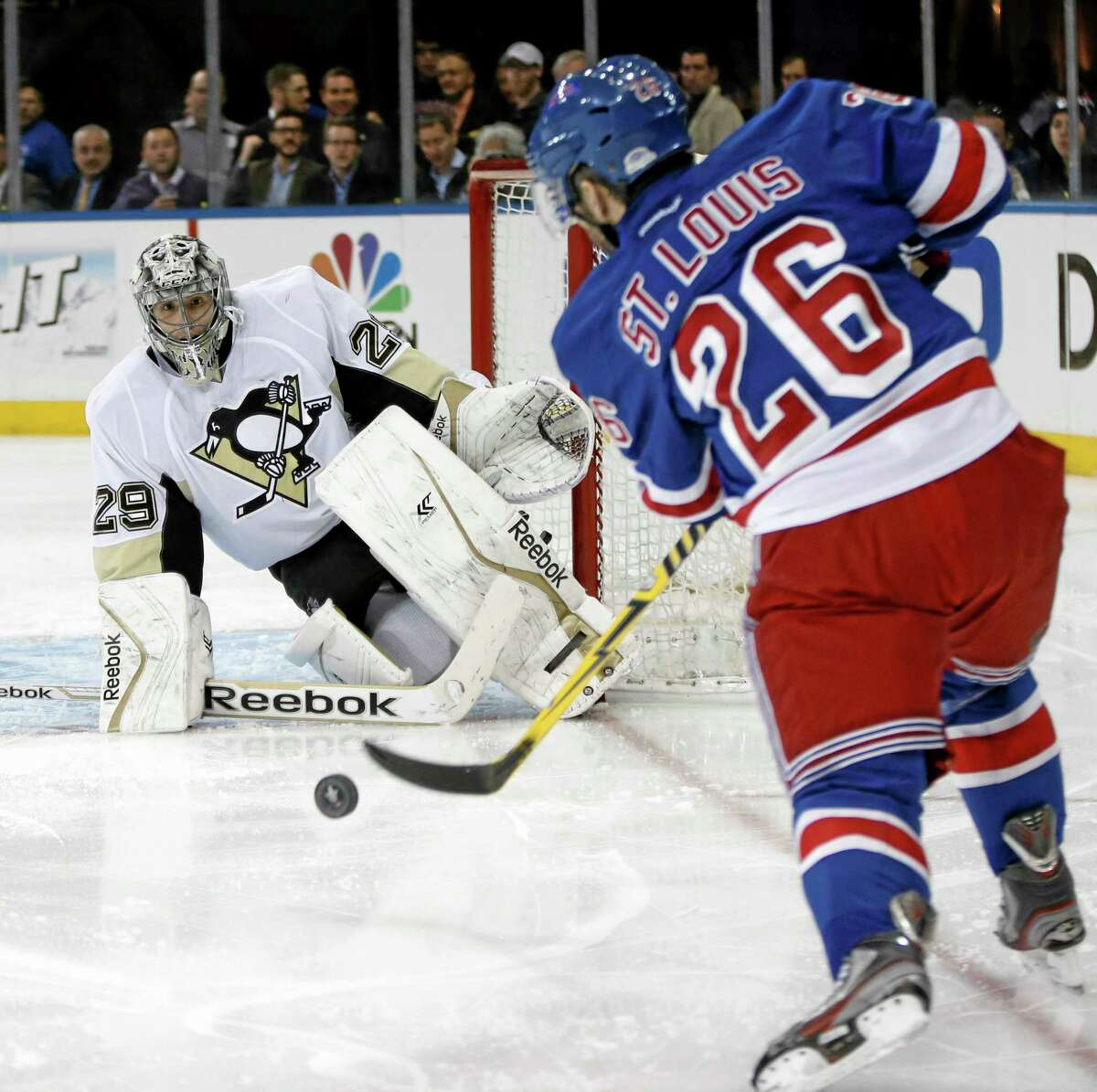 Rangers right wing Martin St. Louis takes a shot on Penguins goalie Marc-Andre Fleury in the second period Monday in New York.
