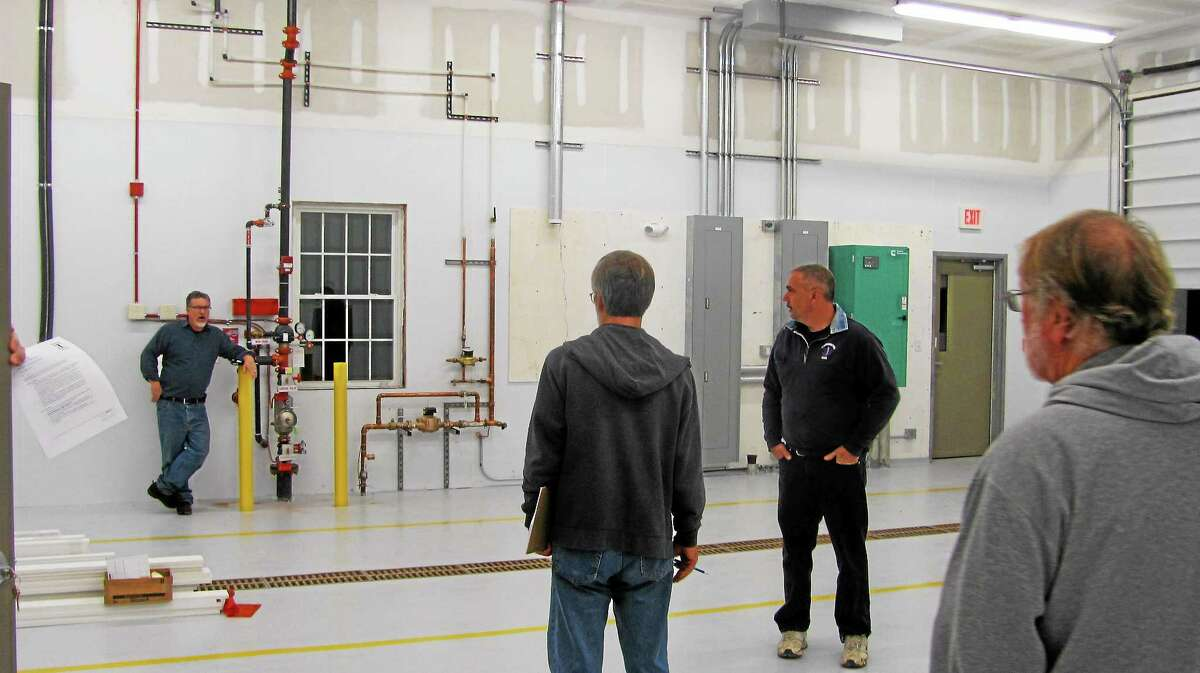 Members of the Harwinton Ambulance Building Committee tour the inside of the town's new emergency services facility, located at 166 Burlington Road.