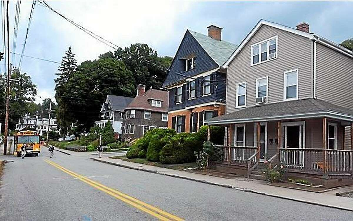 Screenshot: Two sex offenders are living in the home at 152 Broad St. in Norwich, the house on the right, close to where children were getting off the school bus Tuesday. (Aaron Flaum/ NorwichBulletin.com)