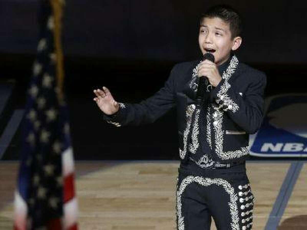 Sebastien De la Cruz sings the U.S. National Anthem before Game 4 of the NBA Finals basketball series between the San Antonio Spurs and the Miami Heat, Thursday, June 13, 2013, in San Antonio. (David J. Phillip/AP)