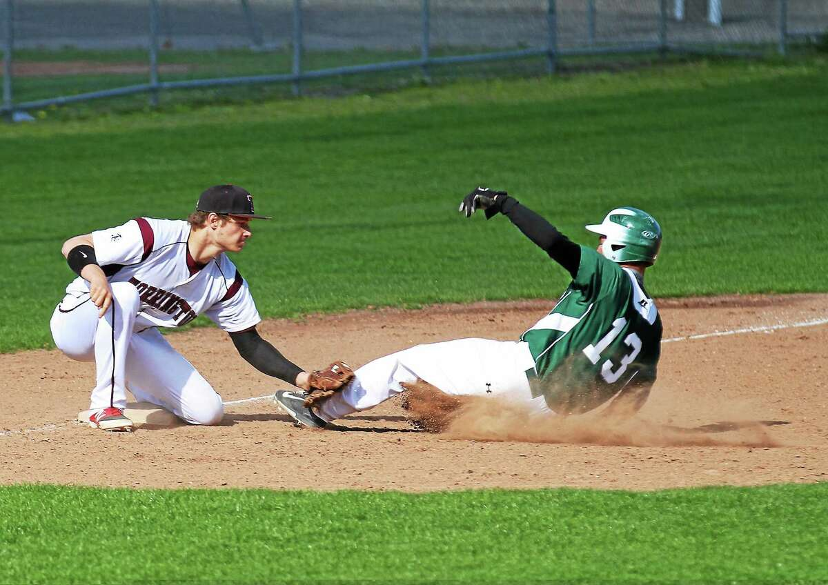 Torrington's Mitch Zagrodnik tags out Wilby's Nelson Merced who was trying to steal third. Torrington won 8-5.
