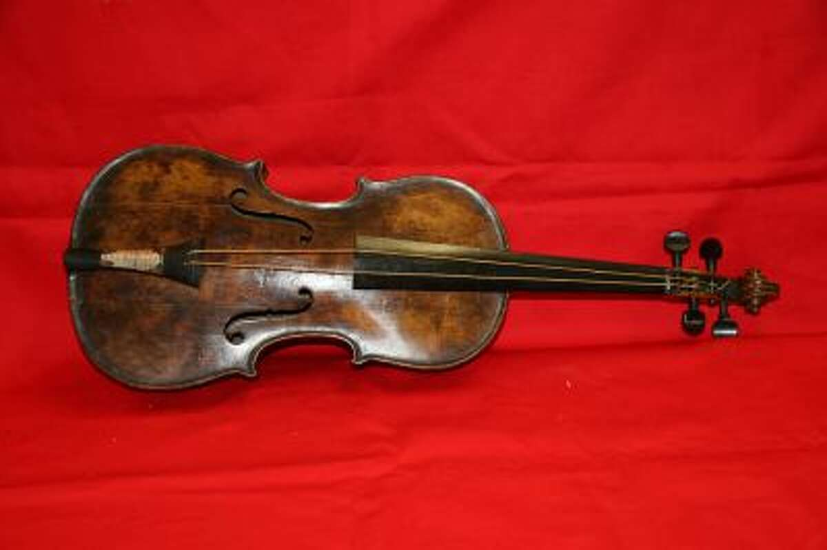 """This is an undated handout image from auction house Henry Aldridge and Son made available on Friday Oct. 18, 2013 shows a violin believed to be the one played by Titanic bandmaster Wallace Hartley will now go on auction. It's a poignant scene familiar to anyone who has watched """"Titanic"""" as the ship slides into the icy waters, musicians perform for the passengers, playing with stoic resolve until the final hour. None of the musicians survived in the 1912 disaster in the North Atlantic...."""