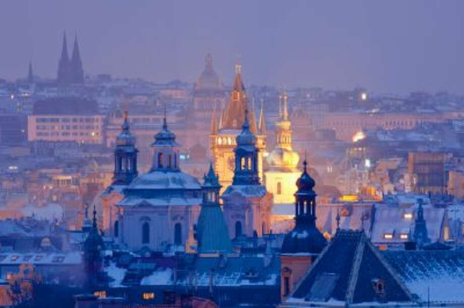 The Spires of the Old Town at dusk in Prague. Photo: Getty Images / (c) Frank Chmura