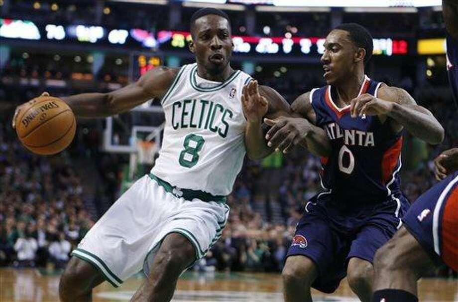 Boston Celtics' Jeff Green (8) drives against Atlanta Hawks' Jeff Teague (0) during the third quarter of an NBA basketball game in Boston, Friday, March 29, 2013. The Celtics won 118-107. (AP Photo/Michael Dwyer) Photo: ASSOCIATED PRESS / AP2013
