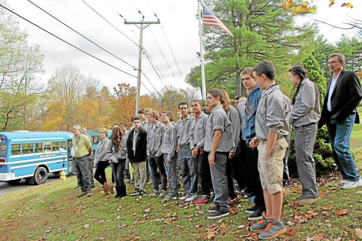 Family, friends, as students and faculty from Oliver Wolcott Technical High School look on during the dedication of the Jerry Dale Cox III Memorial Bridge on Friday, Oct. 18.