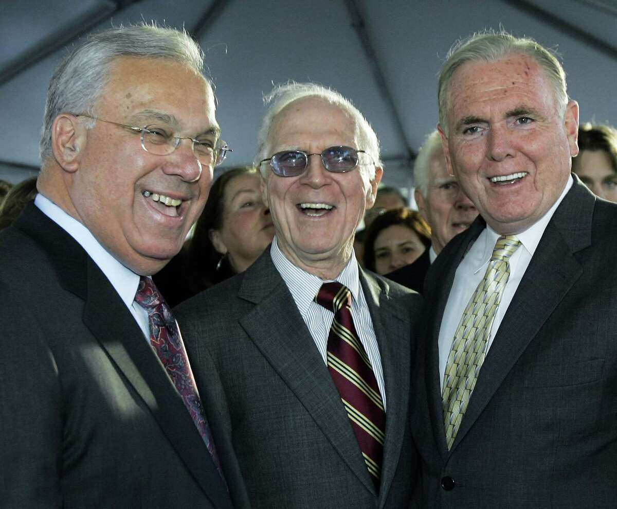 FILE - In this Nov. 1, 2006, file photo, former Boston Mayor Kevin White, center, laughs with Mayor Thomas Menino, left, and former Mayor Raymond Flynn prior to the unveiling of a bronze statue bearing White's likeness in Boston. Menino, who was diagnosed with cancer a month after leaving office in 2013, died Thursday, Oct. 30, 2014, in Boston. He was 71. White died in 2012. (AP Photo/Elise Amendola, File)