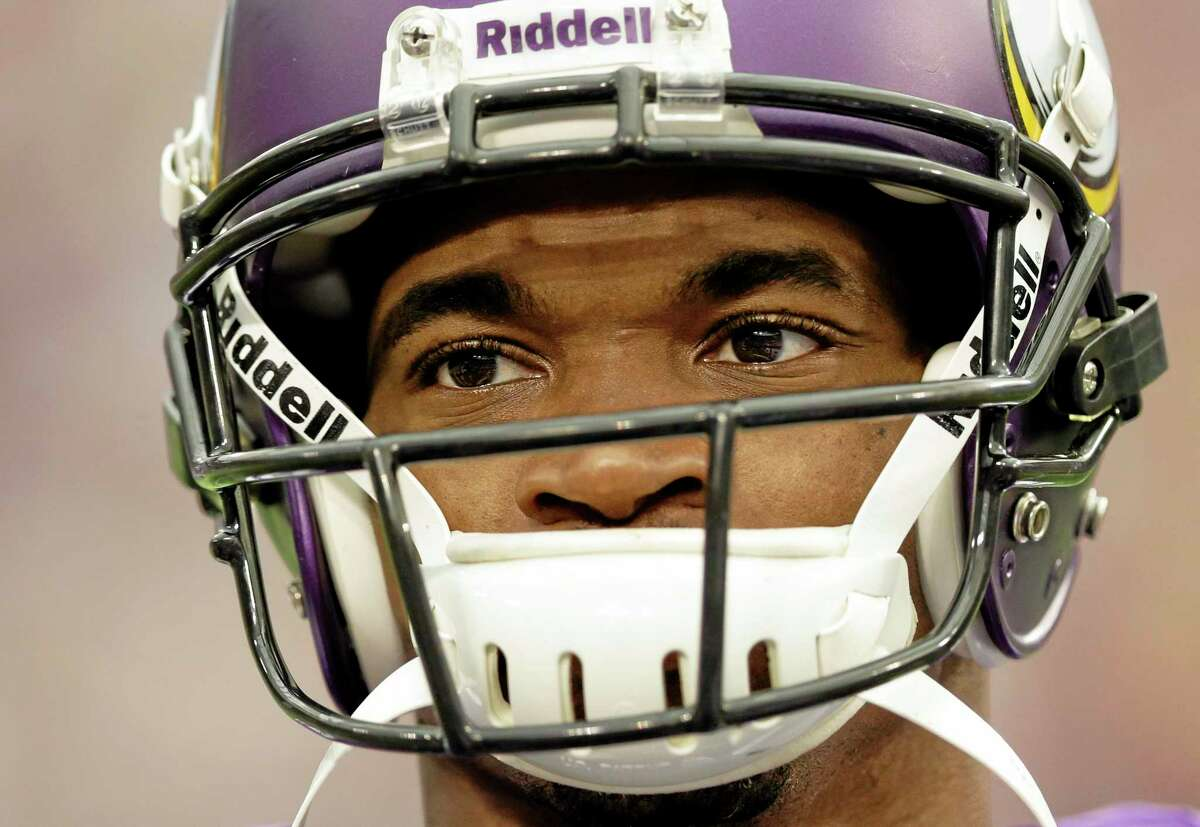 Minnesota Vikings running back Adrian Peterson pauses during introductions before Sunday's game against the Carolina Panthers in Minneapolis.