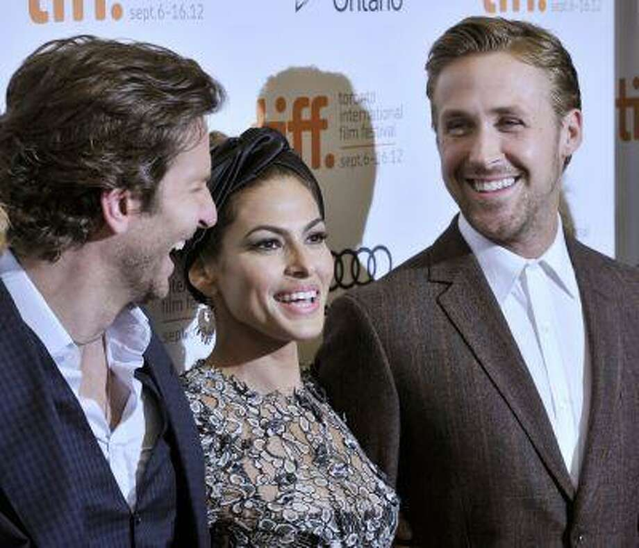 """Actors ( L to R) Bradley Cooper, Eva Mendes and Ryan Gosling pose at the gala presentation for the film """"The Place Beyond The Pines"""" at the 37th Toronto International Film Festival September 7, 2012. REUTERS/Mike Cassese (CANADA - Tags: ENTERTAINMENT) Photo: REUTERS / X01329"""